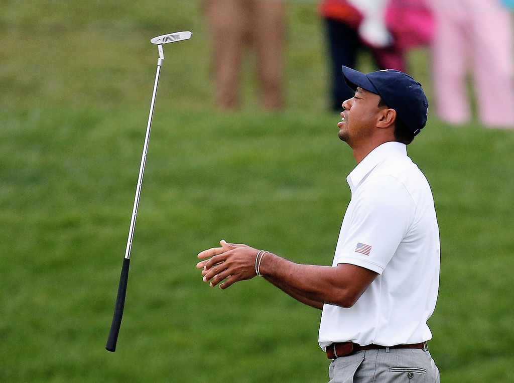 . Tiger Woods of the U.S. Team reacts to a missed putt on the 14th green during the weather-delayed Day Three Foursome Matches at the Muirfield Village Golf Club on October 6, 2013  in Dublin, Ohio.  (Photo by Gregory Shamus/Getty Images)