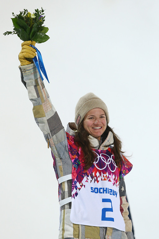 . Bronze Kelly Clark of the United States celebrates during the flower ceremony for the Snowboard Women\'s Halfpipe Finals on day five of the Sochi 2014 Winter Olympics at Rosa Khutor Extreme Park on February 12, 2014 in Sochi, Russia.  (Photo by Cameron Spencer/Getty Images)