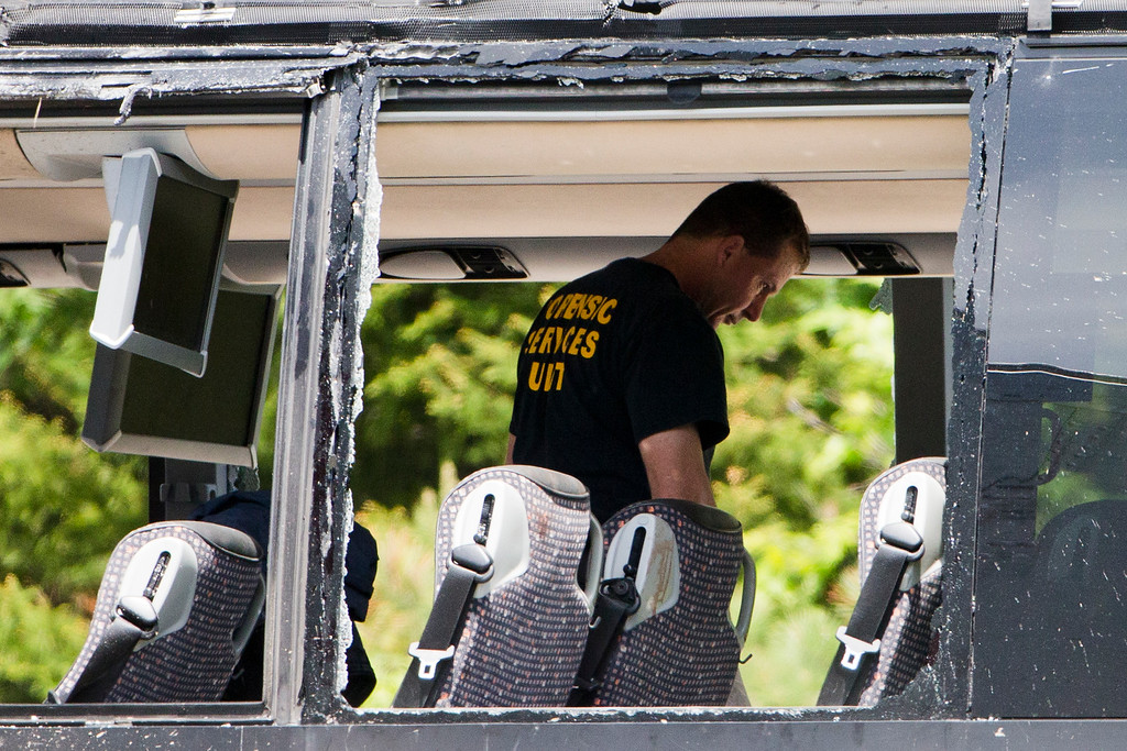 . Authorities investigate the scene of a fatal collision between a tractor-trailer and a tour bus on Interstate 380 near Mount Pocono, Pa., Wednesday, June 3, 2015. Multiple people were killed and more than a dozen were sent to hospitals. (AP Photo/Matt Rourke)