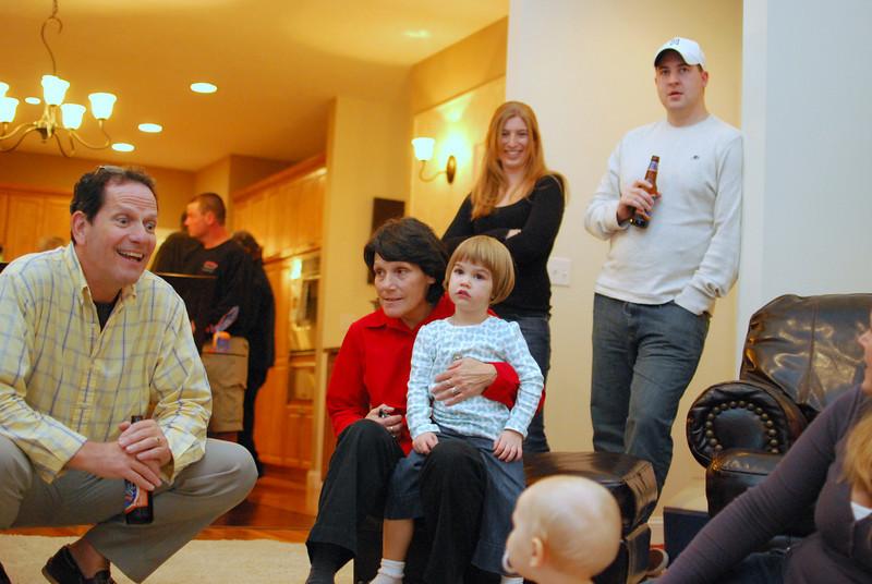 Tom, Darryl, Kali, Kathleen, Roachie (Mike) enjoying Aedan.