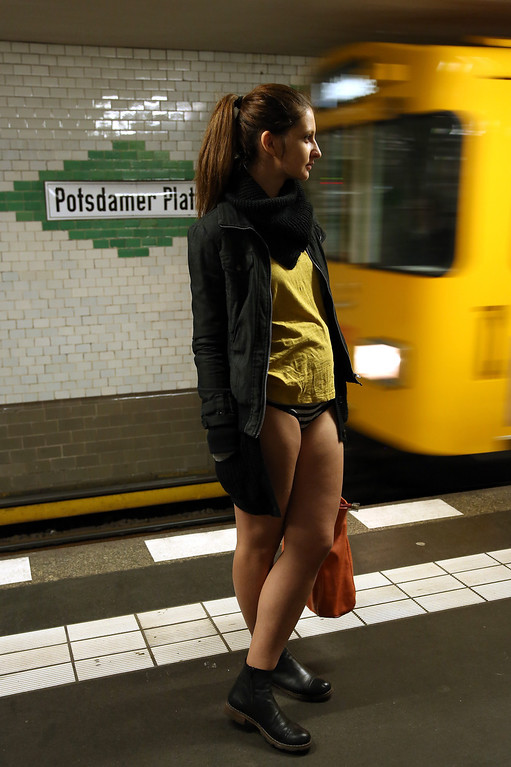 . A participant of the No Pants Subway Ride prepares to board an approaching train on January 12, 2014 in Berlin, Germany. The annual event, in which participants board a subway car in January while not wearing any pants while behaving as though they do not know each other, began as a joke by the public prank group Improv Everywhere in New York City and has since spread around the world, with enthusiasts in around 60 cities and 29 countries across the globe, according to the organization\'s site.  (Photo by Adam Berry/Getty Images)
