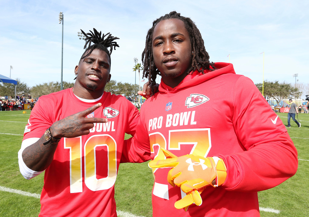 . AFC wide receiver Tyreek Hill, left, and running back Kareem Hunt, both of the Kansas City Chiefs, pose for a photo after Pro Bowl NFL football practice, Thursday, Jan. 25, 2018, in Kissimmee, Fla. (AP Photo/Doug Benc)