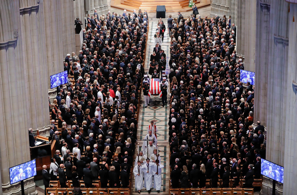 . The family of Sen. John McCain, R-Ariz., follows as his casket is carried during the recessional at the end of a memorial service at Washington National Cathedral in Washington, Saturday, Sept. 1, 2018. McCain died Aug. 25, from brain cancer at age 81. (AP Photo/Pablo Martinez Monsivais)