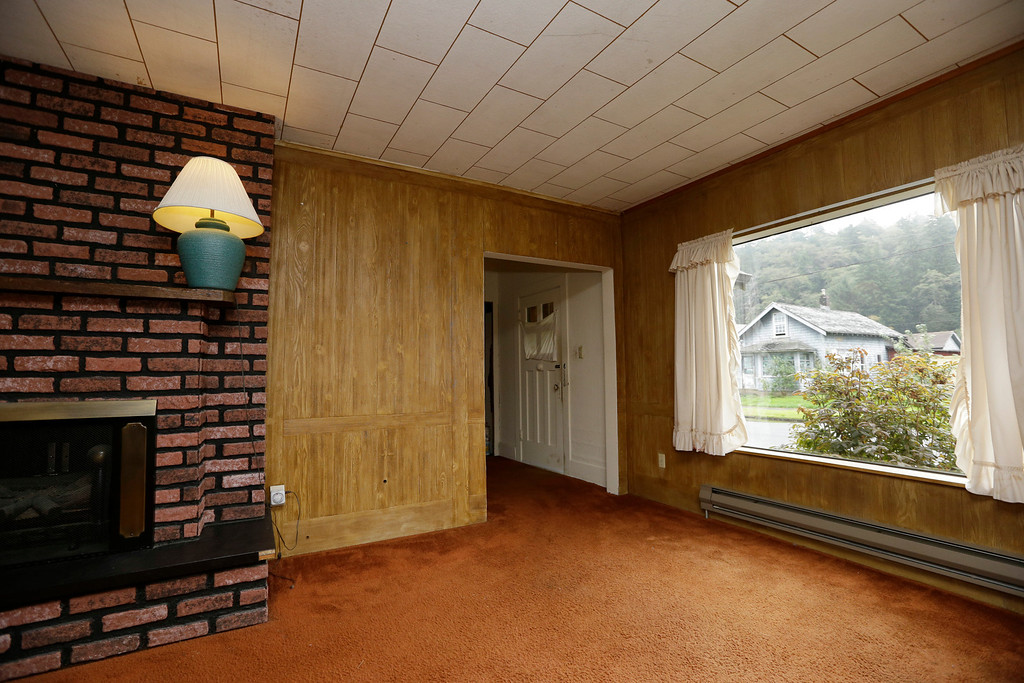 . This photo taken Monday, Sept. 23, 2013, shows the living room of the childhood home of Kurt Cobain, the late frontman of Nirvana, in Aberdeen, Wash. (AP Photo/Elaine Thompson)