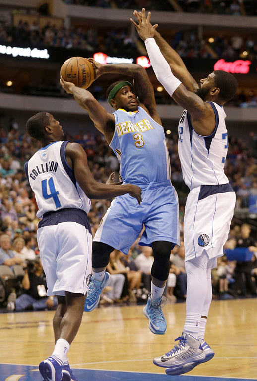 . Denver Nuggets point guard Ty Lawson (3) looks to pass against Dallas Mavericks guards Darren Collison (4) and guard O.J. Mayo (32) during the first half of an NBA basketball game on Friday, April 12, 2013, in Dallas. (AP Photo/LM Otero)