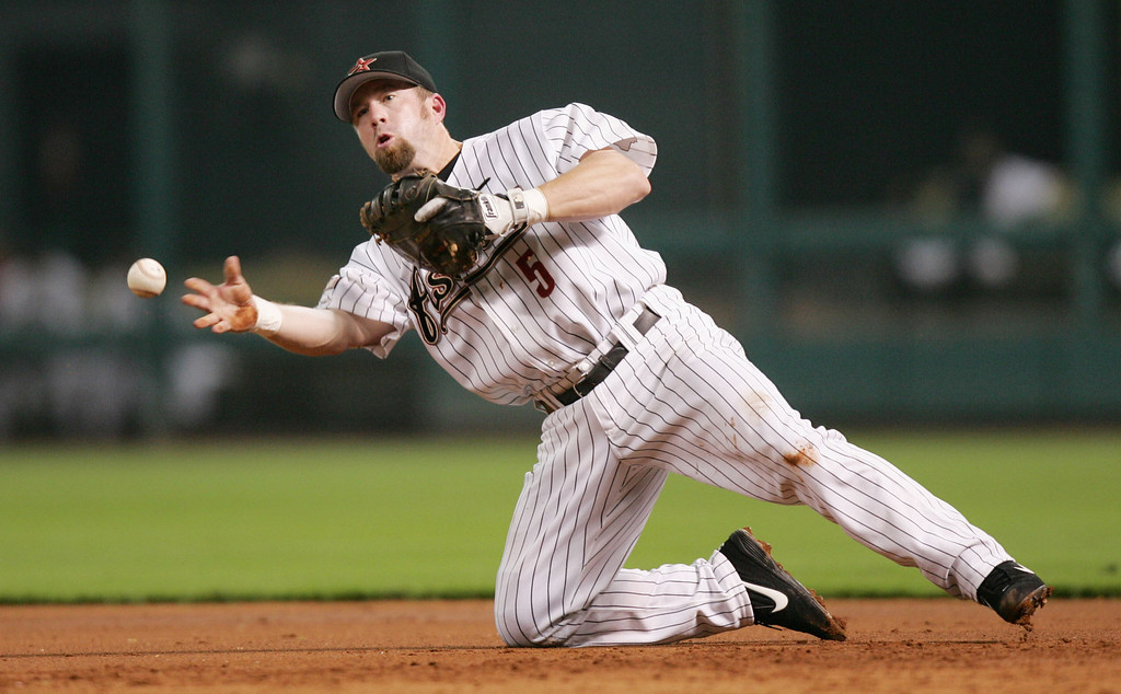 . JEFF BAGWELL -- Houston Astros first baseman Jeff Bagwell throws to first base from his knees after fielding a hit by Atlanta Braves\'  Rafael Furcal during the third inning on Aug. 5, 2004, in Houston.    (AP Photo/David J. Phillip)
