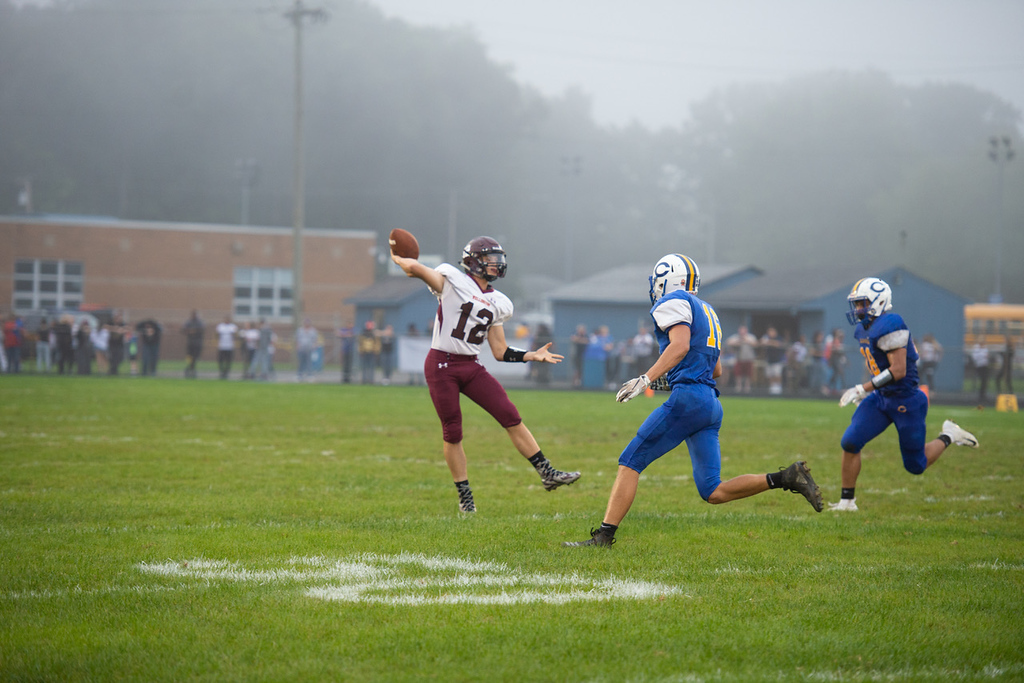. Aimee Bielozer - The Morning Journal<br> Wellington quarterback Ben Higgins throw under heavy pressure by the Clearview defense on Sept. 14.