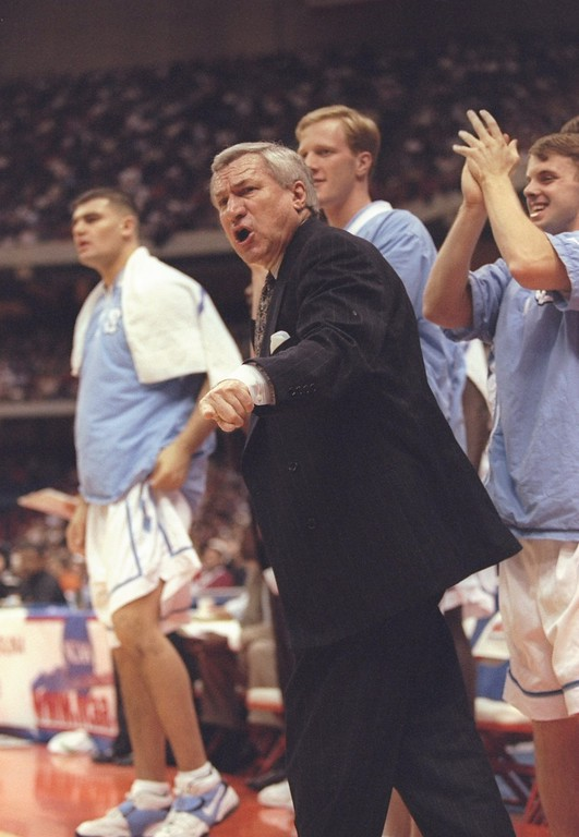 . FILE - FEBRUARY 8:  According to reports February 8, 2015, former North Carolina Tar Heels basketball coach Dean Smith has died at the age of 83. 21 Mar 1997: Coach Dean Smith (right) of the North Carolina Tarheels gives instructions to his players during a playoff game against the California Bears at the Carrier Dome in Syracuse, New York. The Tarheels won the game 63 - 57.