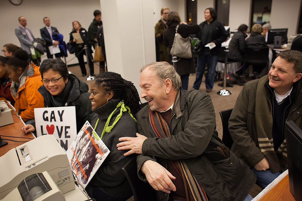. From left, Zone Montoya, Tasha Bassett, Nick Chicka, and Jeff Lovern share a laugh as they receive their marriage licenses at the King County Recorder\'s Office just after 3:00 a.m. on December 6, 2012 in Seattle, Washington. Chicka and Lovern have been together for 37 years and will hold a ceremony this winter on their anniversary. The Recorder\'s Office opened at 12:01 a.m. to begin issuing marriage licenses to same-sex couples for the first time after Washington voters chose to legalize gay marriage in November\'s election. (Photo by David Ryder/Getty Images)