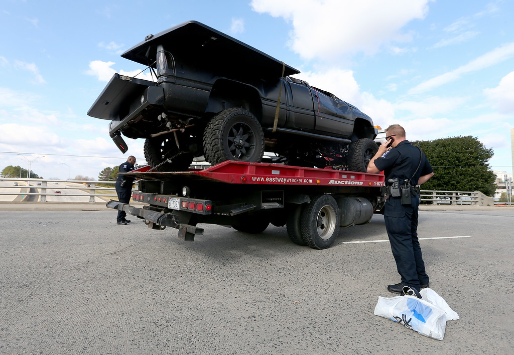 . A pickup truck belonging to quarterback Cam Newton of the Carolina Panthers, that was involved in a roll over accident, is towed away from in front of Bank of America Stadium on December 9, 2014 in Charlotte, North Carolina. Newton was transported from the scene in an ambulance after he was involved in a car accident.  (Photo by Streeter Lecka/Getty Images)