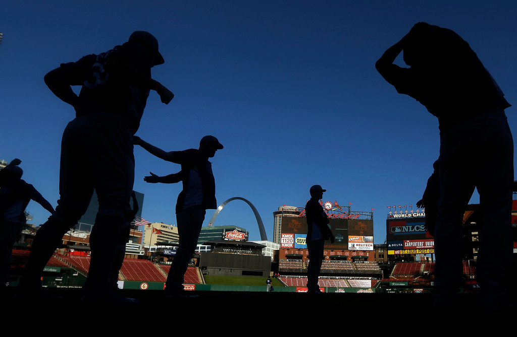 . The Los Angeles Dodgers stretch before Game 1 of the National League baseball championship series against the St. Louis Cardinals Friday, Oct. 11, 2013, in St. Louis. (AP Photo/Jeff Roberson)