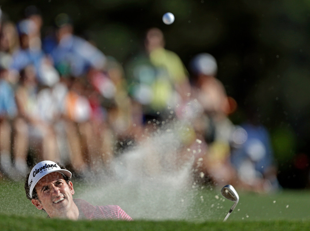 . Gonzalo Fernandez-Castano, of Spain, hits out of a bunker on the 18th hole during the third round of the Masters golf tournament Saturday, April 13, 2013, in Augusta, Ga. (AP Photo/David Goldman)