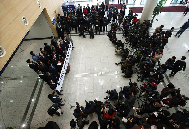 . South Korean small business owners who run factories in the sprawling complex in North Korea\'s border city of Kaesong, hold a press conference to demand that the North Korea to normalize the border crossings in front of the gateways to North Korea at the customs, immigration and quarantine office in Paju, South Korea, near the border village of Panmunjom, Thursday, April 4, 2013. North Korea on Wednesday barred South Korean workers from entering a jointly run factory park just over the heavily armed border in the North, officials in Seoul said, a day after Pyongyang announced it would restart its long-shuttered plutonium reactor and increase production of nuclear weapons material.  (AP Photo/Ahn Young-joon)