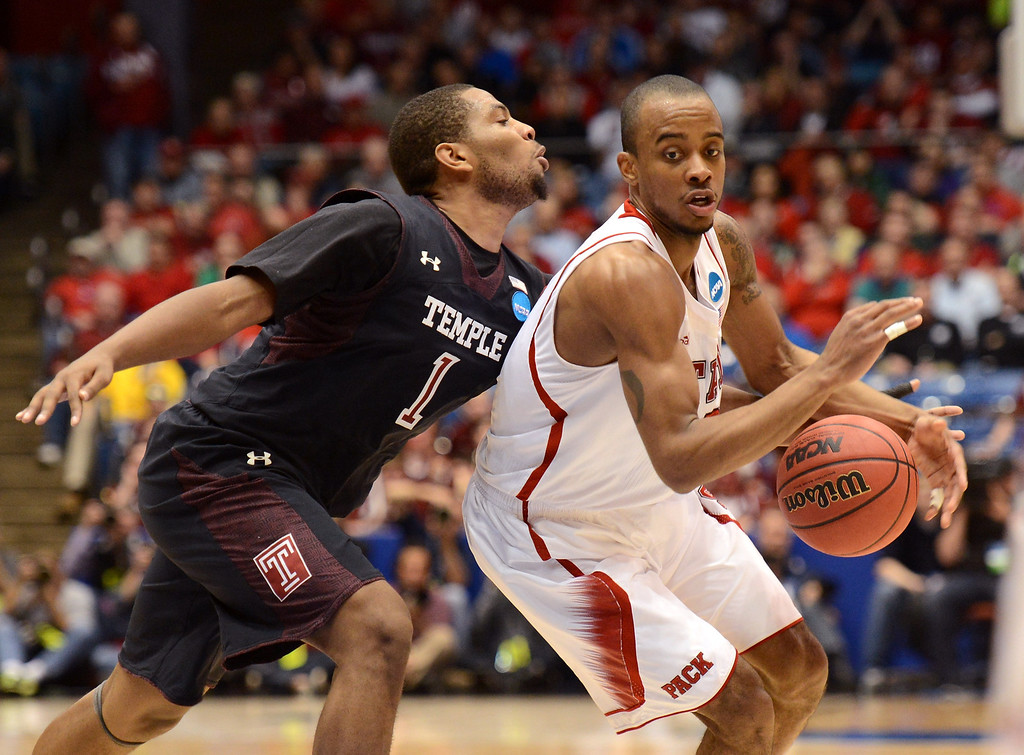 . DAYTON, OH - MARCH 22: Khalif Wyatt #1 of the Temple Owls reaches for the ball against Lorenzo Brown #2 of the North Carolina State Wolfpack in the second half during the second round of the 2013 NCAA Men\'s Basketball Tournament at UD Arena on March 22, 2013 in Dayton, Ohio.  (Photo by Jason Miller/Getty Images)