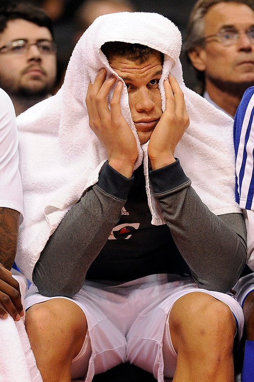 . The Clippers\' Blake Griffin #32 hangs his head on the bench during their game against the Spurs at the Staples Center in Los Angeles Friday, February  21, 2013. The Spurs beat the Clippers 116-90. (Hans Gutknecht/Staff Photographer)