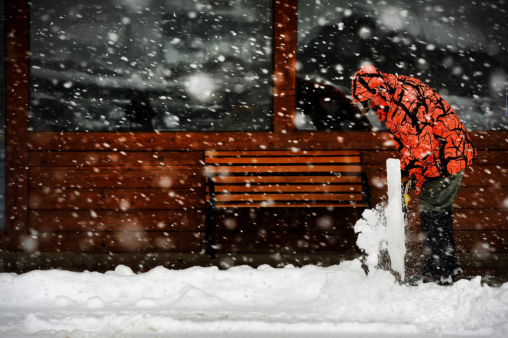 . Steve Hauser shovels snow off sidewalks in downtown Nederland, CO on May 1, 2013.   (Photo by Helen H. Richardson/The Denver Post)