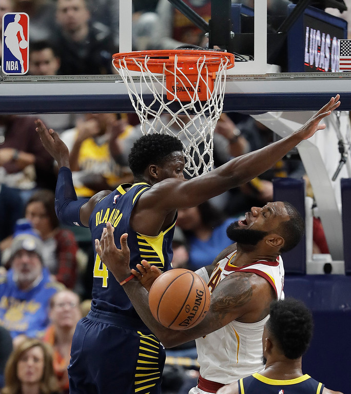 . Cleveland Cavaliers\' LeBron James is fouled by Indiana Pacers\' Victor Oladipo as he goes up for a shot during the second half of an NBA basketball game Friday, Dec. 8, 2017, in Indianapolis. The Pacers won 106-102. (AP Photo/Darron Cummings)