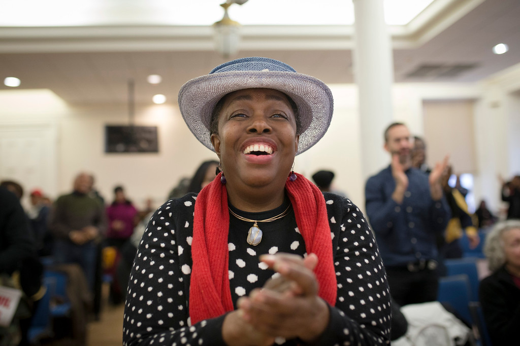 ". Yolande Nicholson, of the Brooklyn borough of New York, cheers following a speech by President Barack Obama broadcast on TV marking the 50th Anniversary of the march across the Pettus Bridge in Selma, Ala., Saturday, March 7, 2015, in New York. Obama spoke from the riverside Alabama town to commemorate ""Bloody Sunday,\"" the day in 1965 when police attacked marchers demonstrating for voting rights. (AP Photo/John Minchillo)"