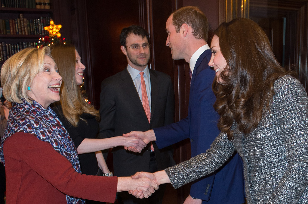 . Catherine, Duchess of Cambridge (R) meets former United States Secretary of State, Hillary Clinton as Prince William, Duke of Cambridge meets Chelsea Clinton during a conservation reception at British Consul General\'s Residence on December 8, 2014 in New York City.  (Photo by Samir Hussein - Pool/Getty Images)
