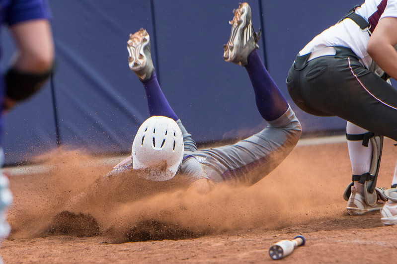 JaeCie Wilson (13) slides into home for the game scoring point for Weber State during the Big Sky Softball Championships against the Montana Grizzlies at Weber State University on May 6, 2017.