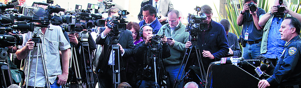 . Santa Cruz Police Chief Kevin Vogel, far right, speaks to the media about the murder of detectives Elizabeth Butler and Loran \'Butch\' Baker during a press conference Wednesday morning. (Shmuel Thaler/Sentinel)
