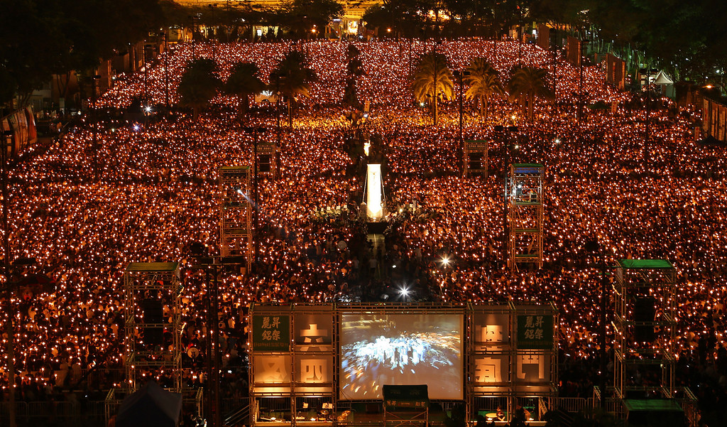 . Tens of thousands of people attend a candlelight vigil at Victoria Park in Hong Kong Wednesday, June 4, 2014, to mark the 25th anniversary of the June 4th Chinese military crackdown on the pro-democracy movement in Beijing. (AP Photo/Cyrus Wong)