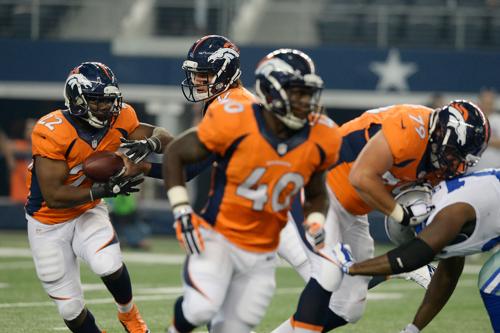 . ARLINGTON, TX - AUGUST 28: Denver Broncos quarterback Brock Osweiler (17) hands off to Denver Broncos running back C.J. Anderson (22) during the first quarter against the Dallas Cowboys August 28, 2014 at AT&T Stadium. (Photo by John Leyba/The Denver Post)