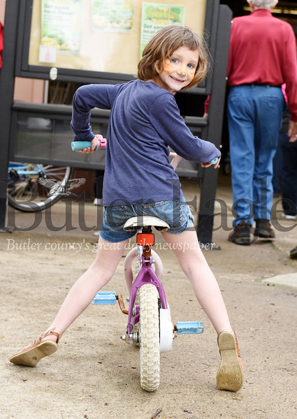 Harold Aughton/Butler Eagle: Reva Smith, 7, of Butler tries out her new bike at the Bike Rodeo.