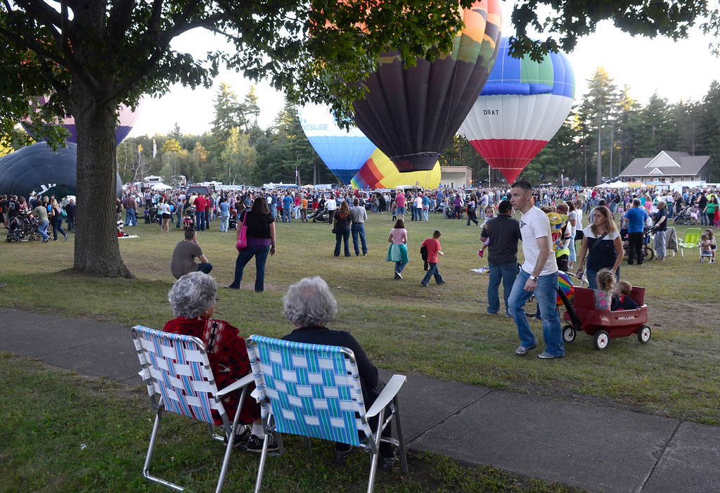 . Balloons lift off from Crandall Park in Glens Falls Thursday evening during the opening night of the Adirondack Hot Air Balloon Festival. Photo Ed Burke/SARATOGIAN 9/19/13