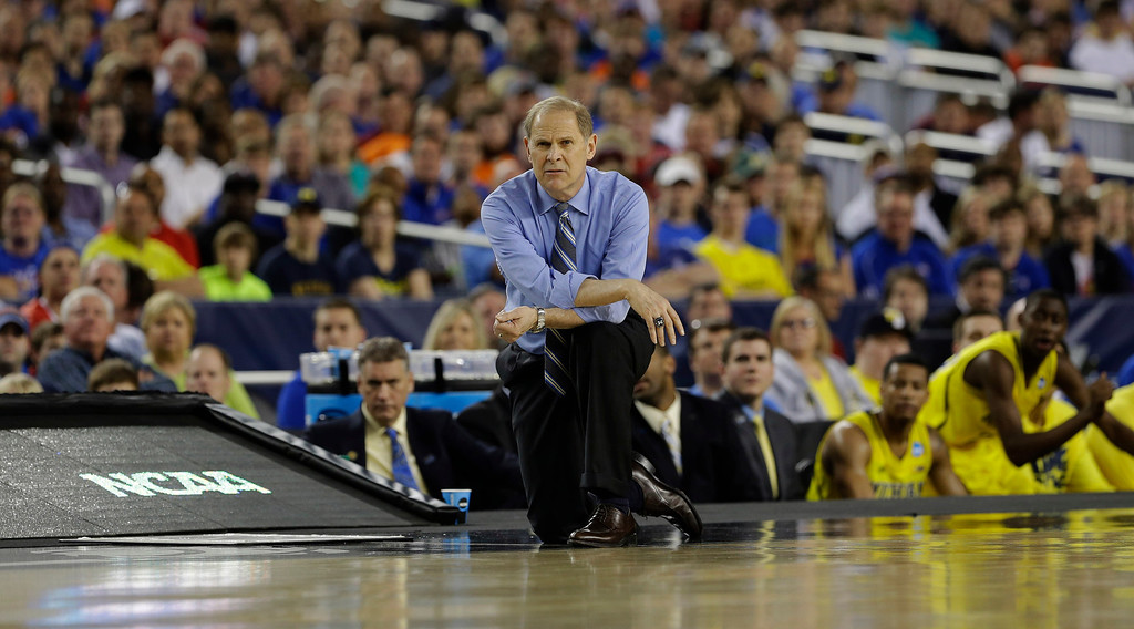 . Michigan head coach John Beilein watches during the first half of a regional semifinal game against Kansas in the NCAA college basketball tournament, Friday, March 29, 2013, in Arlington, Texas. (AP Photo/Tony Gutierrez)