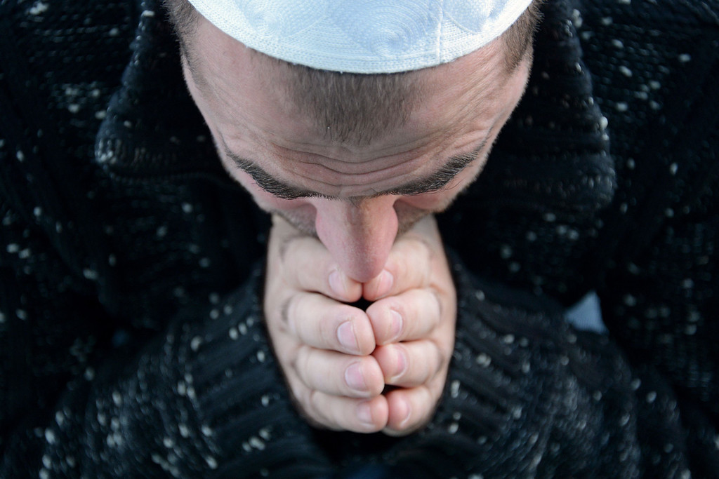. A Russian Muslim prays outside Moscow\'s central mosque on October 15, 2013, during celebrations of Eid al-Adha (Kurban Bayram).  AFP PHOTO/KIRILL KUDRYAVTSEV/AFP/Getty Images