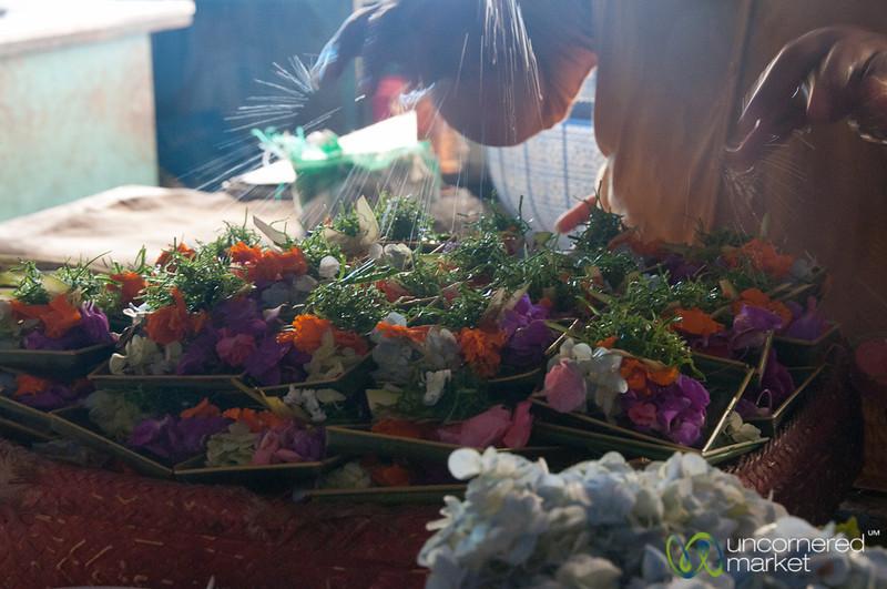 Sprinkling Water on Offerings - Bali, Indonesia