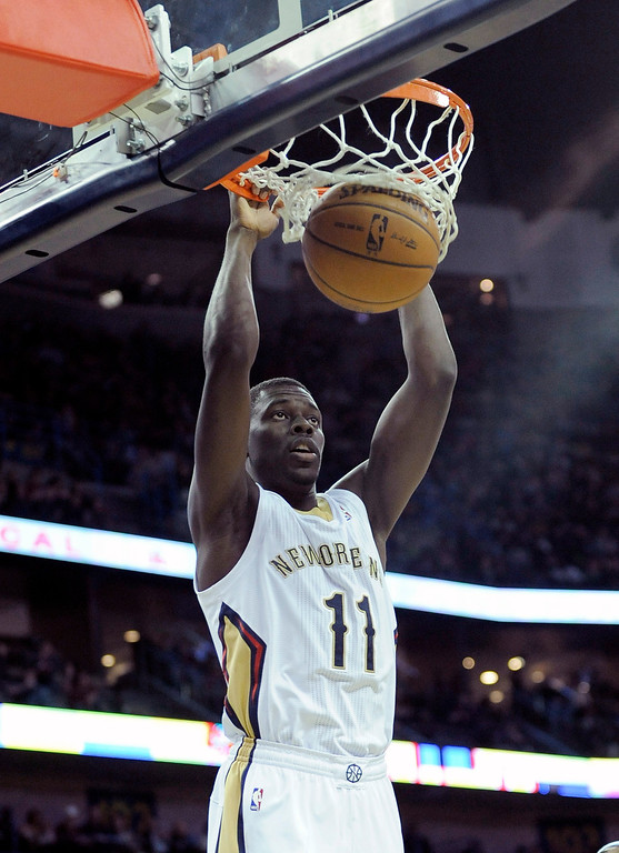 . New Orleans Pelicans guard Jrue Holiday (11) scores against the Denver Nuggets in the second half of an NBA basketball game in New Orleans, Friday, Dec. 27, 2013. New Orleans won 105-89. (AP Photo/Stacy Revere)