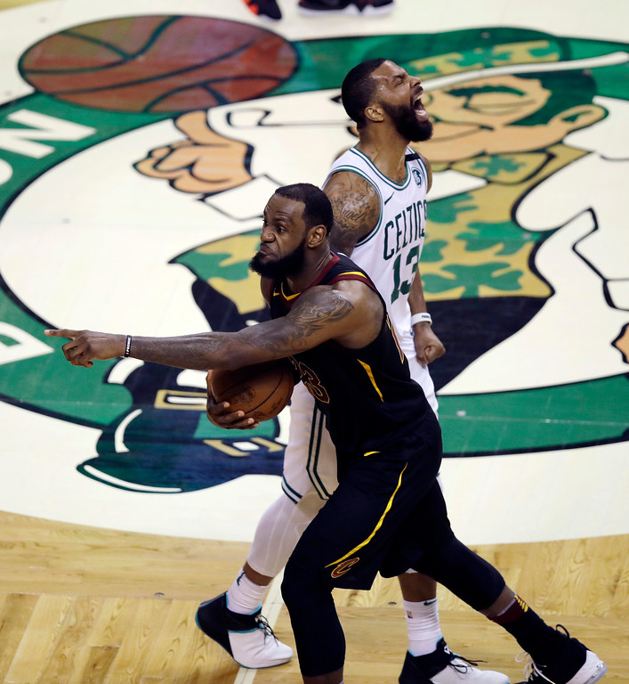 . Boston Celtics forward Marcus Morris, rear, and Cleveland Cavaliers forward LeBron James, front, react after James didn\'t cross the half court line in the allotted time during the second half in Game 7 of the NBA basketball Eastern Conference finals, Sunday, May 27, 2018, in Boston. (AP Photo/Charles Krupa)
