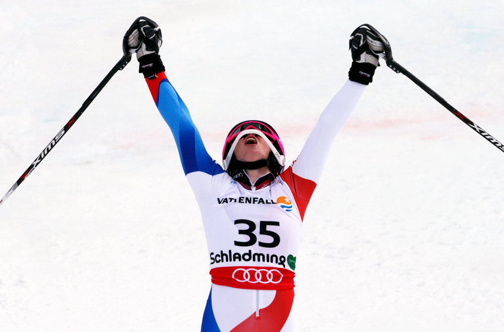 Description of . Michelle Gisin of Switzerland reacts after her second run of the women's Slalom race at the World Alpine Skiing Championships in Schladming February 16, 2013.    REUTERS/Ruben Sprich