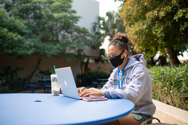 Freshman Cierra Adger utilizes the outdoor spaces to study on her laptop.