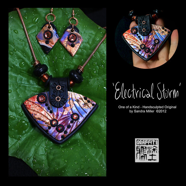 """ELECTRICAL STORM necklace and earring  set  This Signature set is simply breathtaking and is the only """"non critter"""" set I did for this Trunk Show.    The central pendant and earrings  were sculpted of polymer clay which first has been layered in iridescent finishes,metallic leaf and inks which echo  Raku glazing on Japanese porcelain pottery. Jaw dropping in person!!  This technique requires days of working with the clay before a finished product is complete.  The real copper leaf really jumps out agains the electric blues and purples which shift color in the changing light.    I created a riveted bail from the clay and impressed a floral pattern in it which looks very much like black tooled leather.  4 Swarovski crystals were set in black bezels on the surface to add a very fun texture and contrast to the design.  Black also surrounds the bottom edge for a striking detail.  The earrings are detailed to perfectly match the pendant    The beads on the necklace can be removed or added to and consist of black wood rondelles, copper rings and dichotic copper glass tile beads.  The photos simply don't show off the rich glitz and tones of this pendant which I promise is 10x as dramatic in person.  Very light weight and gorgeous, this is a perfect every day design as it goes so well with neutrals and denim!!   This will quickly become your """"go to"""" accessory!!  PENDANT MEASURES  2 1/2  x 2 1/2""""    High quality caprice snake chain is adjustable from 16-20"""" long  Beads may be changed or removed by unscrewing end EARRINGS MEASURE 1"""" long    PENDANT MEASURES  2 1/2  x 2 1/2""""    High quality caprice snake chain is adjustable from 16-20"""" long   Beads may be changed or removed by unscrewing end EARRINGS MEASURE 1"""" long"""
