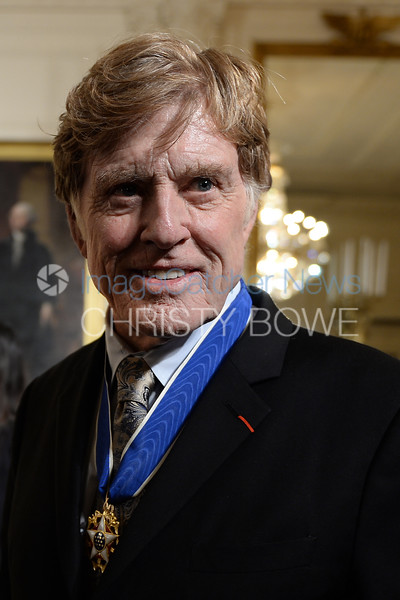 Robert Redford talks to the media following his receiving the Presidential Medal of Freedom.