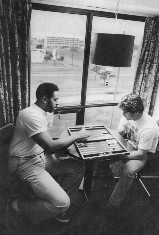 . JAN 1978 - Bronco Players \'Live It Up\' At Team Headquarters. Brison Manor, left, Denver Broncos defensive lineman and defensive back Randy Rich Kill time with game of back Randy Rich kill time with game of backgammon at team\'s New Orleans motel. (Bill Wunsch/The Denver Post)