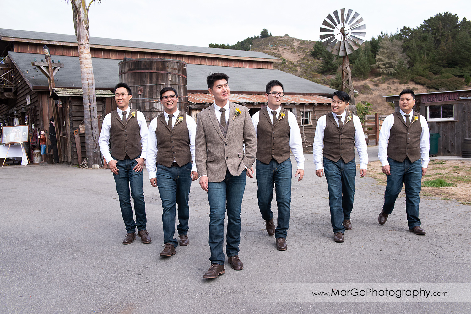 groom and groomsmen walking at Long Branch Saloon & Farms in Half Moon Bay