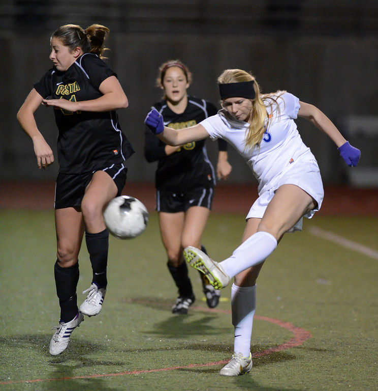 . Westlake\'s Roni Merrill takes a shot as Mira Costa\'s Melina Cohen tries to defend during quarterfinal action.  Westlake defeated Mira Costa 1-0 in the quarterfinal.  Photo by David Crane/Staff Photographer