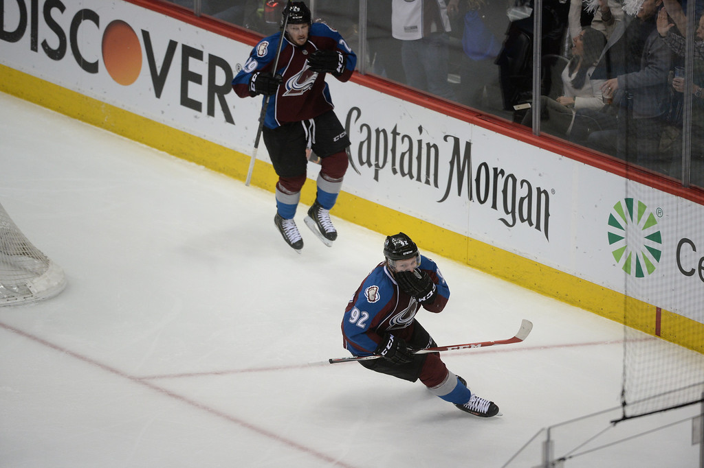 . Gabriel Landeskog (92) and Nathan MacKinnon (29) of the Colorado Avalanche react after a second Landeskog goal during the second period of action.  (Photo by Karl Gehring/The Denver Post)
