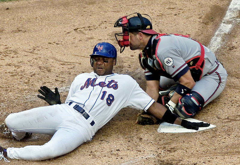 . In this June 23, 2001, file photo, New York Mets\' Darryl Hamilton is tagged out at home plate by Atlanta Braves catcher Javy Lopez during the third inning of a baseball game at Shea Stadium in New York. Authorities say Hamilton was killed Sunday, June 21, 2015, in a murder-suicide in the Houston suburb of Pearland, Texas. Pearland police say an initial investigation has determined Hamilton had been shot several times and that a woman in the home died of a self-inflicted gunshot wound. The woman was identified as Monica Jordan. (AP Photo/Lou Requena, File)