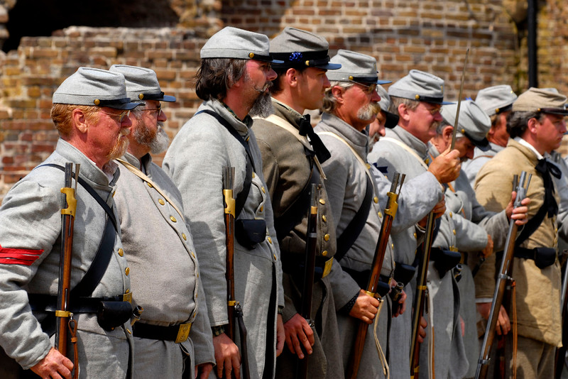 """Confederate """"troops"""" stand inside the fort after the Federal troops """"surrendered"""" at Ft. Sumter during a reenactment of the surrender ceremony in Charleston, South Carolina on Thursday, April 14, 2011. ..The 150th Anniversary of the Firing on Ft. Sumter was commemorated with lectures, performances, demonstrations, and a living history throughout the area on James Island, Charleston, Mt. Pleasant, and Sullivan's Island during the week from April 8-14, 2011. Photo Copyright 2011 Jason Barnette"""