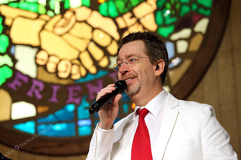AMER-CMM 00006 Heritage Singers Dave Bell wows a church audience with his awesome deep voice by Peter J Mancus.JPG