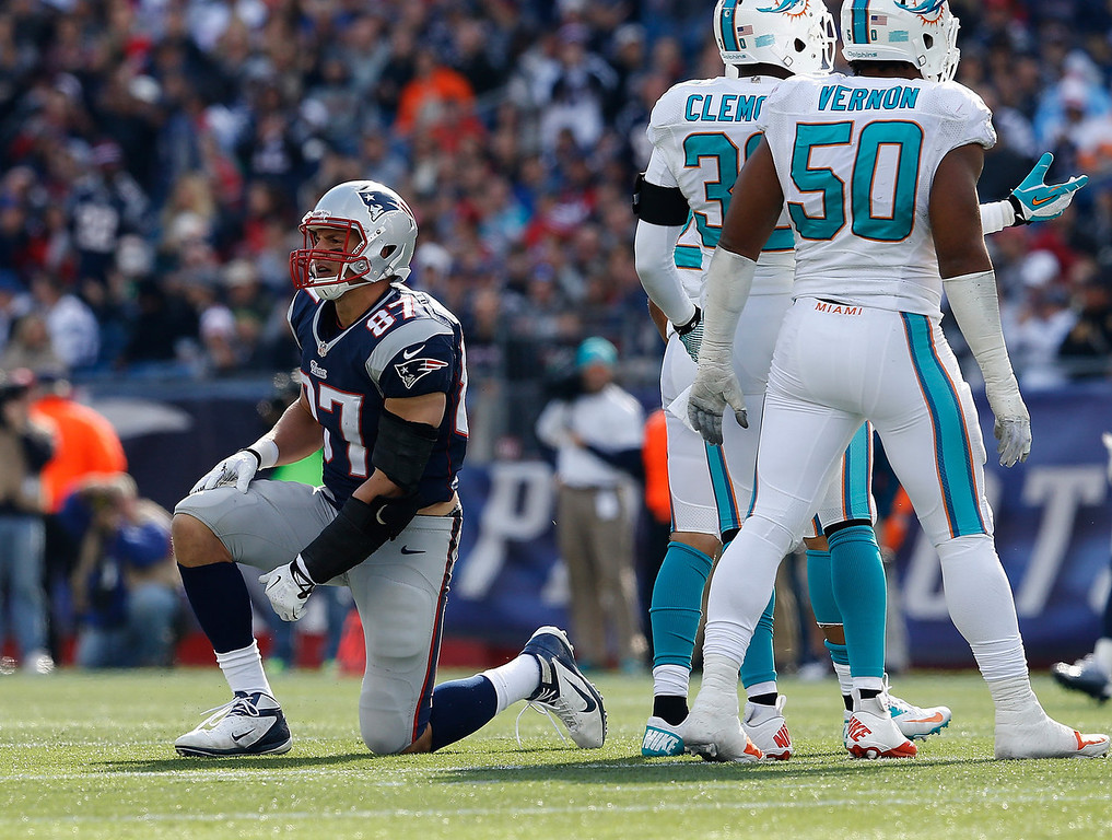 . Rob Gronkowski #87 of the New England Patriots takes a breather after an incomplete pass against the Miami Dolphins defends in the first half at Gillette Stadium on October 27, 2013 in Foxboro, Massachusetts. (Photo by Jim Rogash/Getty Images)