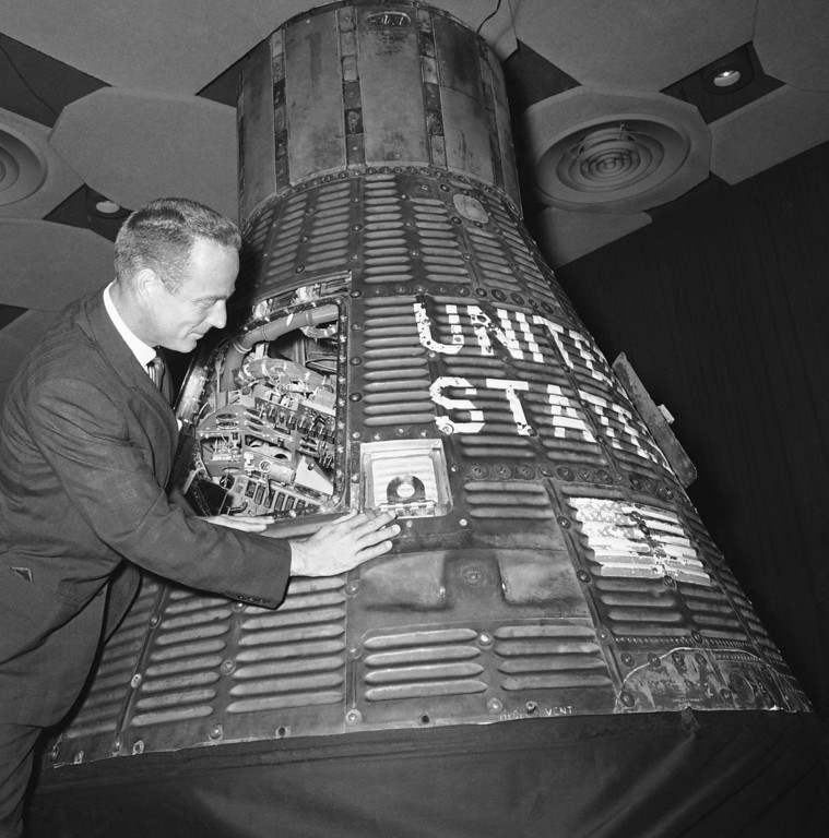 . Astronaut M. Scott Carpenter, left, gives his Aurora 7 spacecraft another look, August 21, 1962 in Houston, Texas just prior to giving the pilot?s flight report on the MA-7 orbital space flight. The Manned Spacecraft Center presented the formal report on the Carpenter flight to space scientists at a conference. (AP Photo)