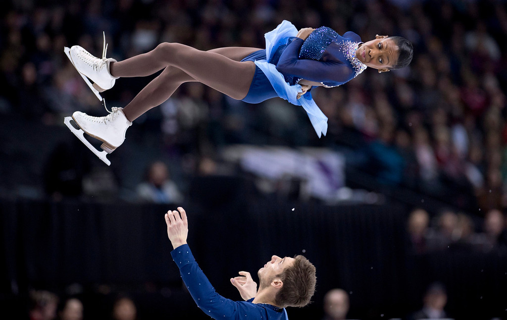 . Venessa James and Morgan Cipres from France, perform their free skate program in the pairs competition at the World Figure Skating Championships Friday, March 15, 2013 in London, Ontario. (AP Photo/The Canadian Press, Paul Chiasson)