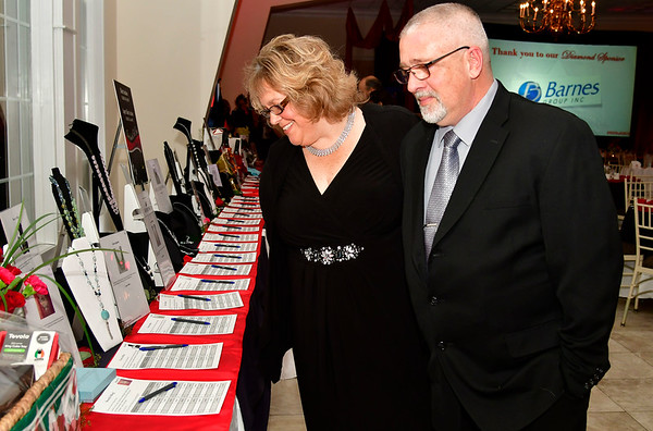 11/17/2018 Mike Orazzi | Staff Theresa and Tom Palmer look over silent auction items during Bristol Hospitals Annual Ball held at the Aqua Turf Club in Southington. All proceeds will benefit the Emergency Center expansion and renovation project.