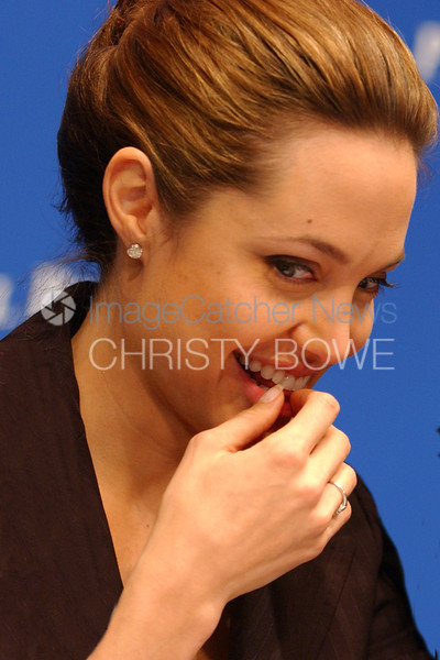 Actress Angelina Jolie reacts to the media at The National Press Club.